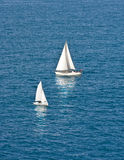 Two White Sailboats on Dark Blue Water Stock Photography