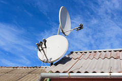 Two white satellite dish on the roof Royalty Free Stock Image