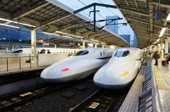 Two white Shinkansen Japanese high speed trains Stock Photos