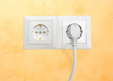 Two white socket outlet with one connected corresponding power p. Block of the two white socket outlets European standard with connected one white power cable stock photos
