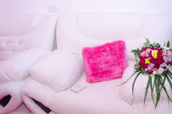 Two white sofa pink pillow and wedding bouquet Royalty Free Stock Photography