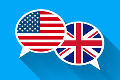 Two white speech bubbles with American and Great britain flags. English language conceptual illustration Stock Photos