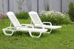 Two white sun loungers Royalty Free Stock Photos