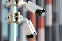 Two white surveillance security cctv cameras. In city Stock Images