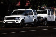 Two white SUV in the city. Royalty Free Stock Images