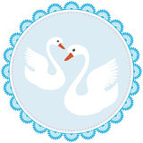 Two white swans on a blue napkin Royalty Free Stock Photography