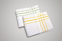 Two White Tablecloth made of cotton with green and yellow stripe Stock Photos