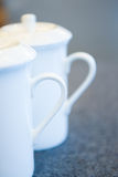 Two white tea cups Royalty Free Stock Photography
