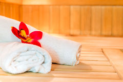 Two white terry towels and beautiful flower Stock Image