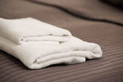 Two white towels lie on a blanket Stock Images