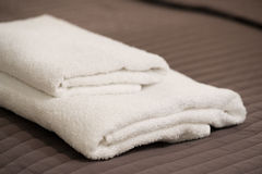 Two white towels lie on a blanket Stock Photo