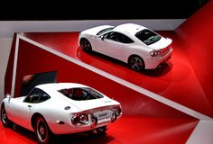 Two white  toyota 2000GT Royalty Free Stock Images