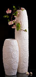 Two white vases with small stem of flowers Royalty Free Stock Image