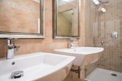 Two white washbasins Royalty Free Stock Photos