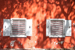 Two White Windows on Old Red Wall Stock Images