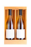 Two White Wine Bottles in Wood Case Stock Photo