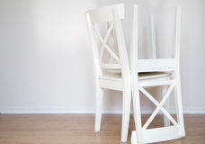 Two white wooden chairs background Royalty Free Stock Photo