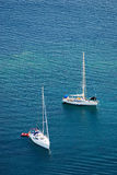 Two white yachts on the blue sea. Two white yacht on the blue sea (view from above royalty free stock photography