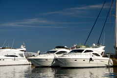 Two white yachts in port. Two yachts in port on a sunset Royalty Free Stock Images