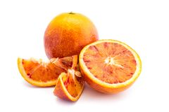 Two whole blood orange and one cut open isolated on white background stock image