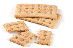 Two whole and the broken grain crispbreads isolated on white background Stock Photography