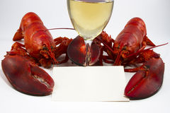 Two Lobsters with Menu or Recipe Card and Wine Gla Stock Images