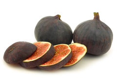 Two whole and a cut fig (Ficus carica) Royalty Free Stock Photography