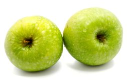 Apple Granny Smith. Two whole green apples Granny Smith isolated on white backgroundn Royalty Free Stock Photo