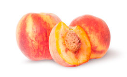 Two whole and half of peach Stock Photography