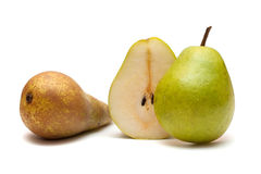 Two Whole and half of pear Royalty Free Stock Photos