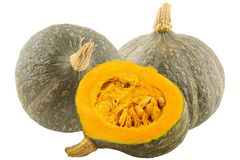 Two whole and half pumpkin isolated on white background. With clipping path for package design Stock Image