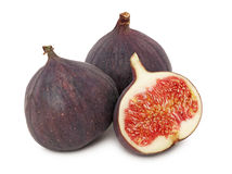 Two whole and a half ripe figs (isolated) Royalty Free Stock Photo