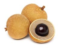 Two whole and a half of ripe longan isolated stock photos