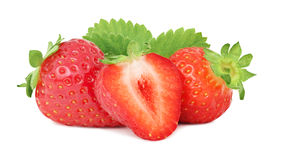 Two whole and a half ripe strawberry with green leaves (isolated Stock Images