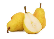 Two whole and a half yellow pears (isolated) Stock Image