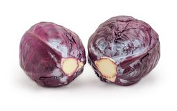 Two heads of the red cabbage on a white background. Two whole heads of the fresh red cabbage on a white background Royalty Free Stock Photo