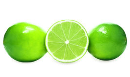 Two whole limes and one half lime on white background Royalty Free Stock Image
