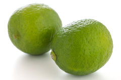 Two whole limes Stock Image