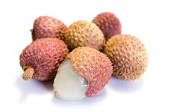 Two whole lychee and one cut open isolated on white background stock images
