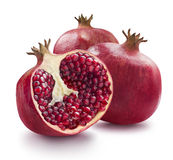 Two whole and one half of pomegranate  on white backgrou Stock Image