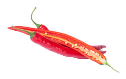 Two whole and one half red chili peppers deployed Stock Photography