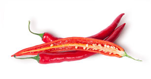 Two whole and one half red chili peppers Royalty Free Stock Photo