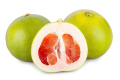 Two whole and one halved Pomelo Fruits Royalty Free Stock Image