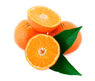 Two whole and one sliced mandarin. With green leaves isolated on white background Stock Images