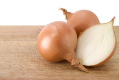 Two whole onions and one cut Stock Photo