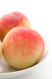 Two whole peaches Stock Images