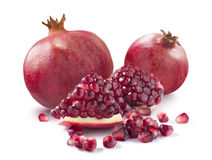 Two whole pomegranate piece and seeds on white backgrou royalty free stock images