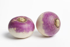 Two whole purple headed turnips Stock Photos