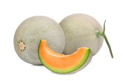 Two whole and slice of japanese melons, orange melon Royalty Free Stock Photos