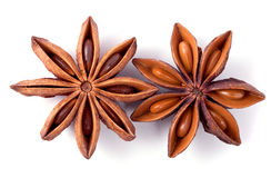 Two whole star anise isolated on white Royalty Free Stock Photography
